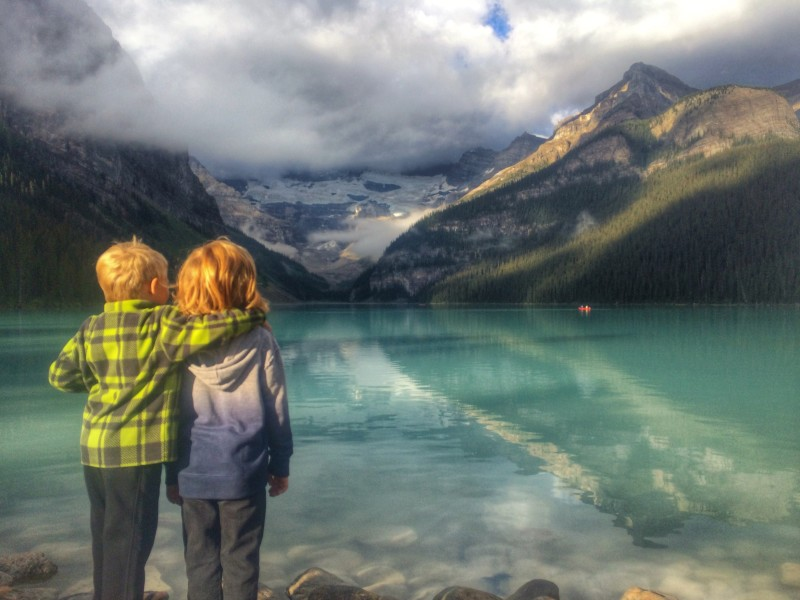 Brothers admiring the view of Lake Louise, Alberta